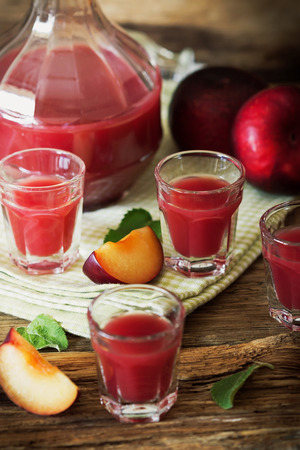 spirituous beverages: Traditional homemade plum liqueur. Alcoholic drinks. Selective focus
