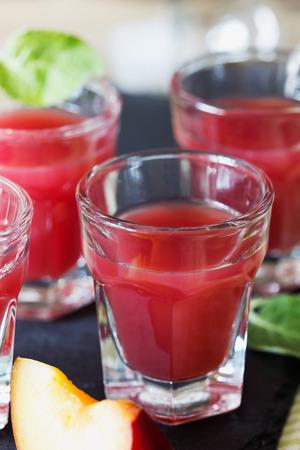 spirituous beverages: Traditional homemade plum liqueur. Alcoholic drinks. Selective focus