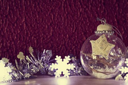 Transparent glass Christmas ball. Christmas decorations. Selective focus. Toned image