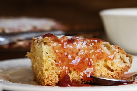 Traditional homemade cake with rhubarb and fruit sauce on the table. Tasty breakfast. Selective focus