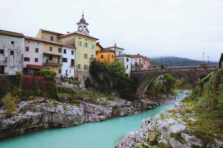 Wonderful view of the beautiful Soča river with stunning green water against the bridge.