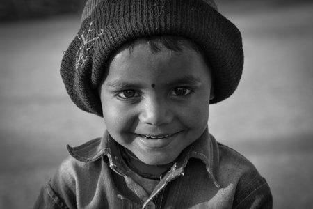TIKAMGARH, MADHYA PRADESH, INDIA - FEBRUARY 11, 2020: Portrait of a little boy in black and white. 報道画像