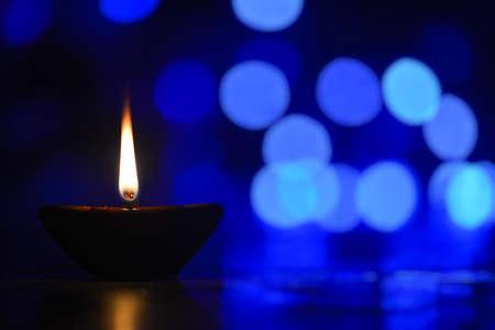 Traditional diya lamp lit during Diwali celebration