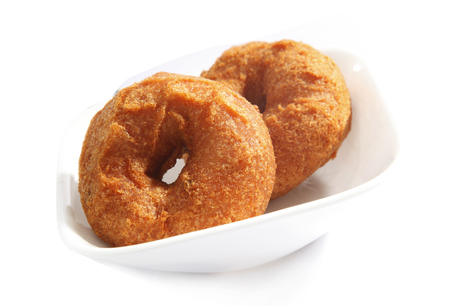 urad dal: vada is donut, made with urad dal flour, indian snack food