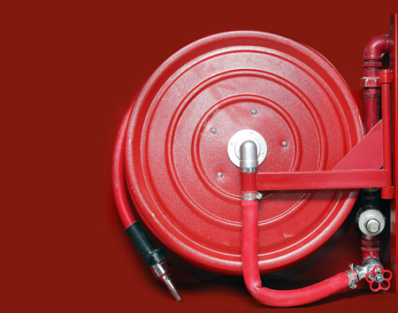 fire hose: firefighter hose on the red background