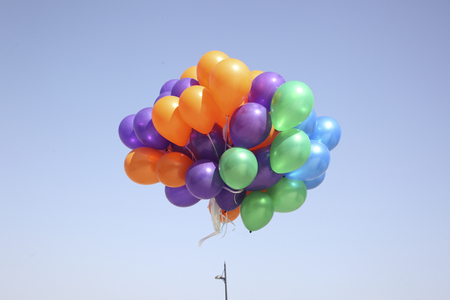 balloons flying in the sky photo