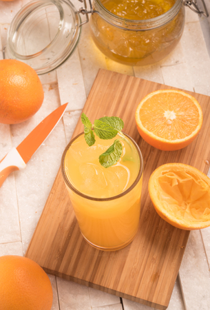 pannel: fresh orange juice in a glass with jam
