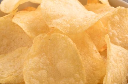 unhealthful: Close up Potato chips background Stock Photo
