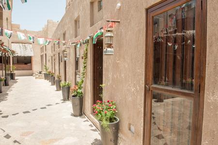 annually: DUBAI - MAY 05, 2016: Street of Deira area on a sunny day. Dubai attracts 15 million visitors annually. Editorial
