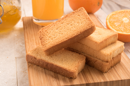 rusk: wheat rusk in a wooden panel with jam