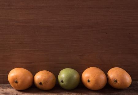 spacing: mango on wooden background Stock Photo