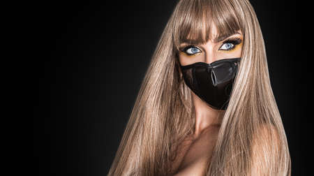 Stay at home awareness social media campaign and coronavirus prevention. Sexy woman with mask promotes coronavirus campaigns. Protect from Coronavirus or Covid-19 epidemic. Mask fashion on black.