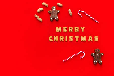 Christmas red background with Christmas food and cookies decor. Top view with copy space. Minimalism. Merry Christmas.