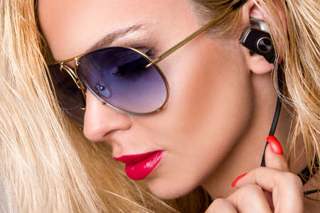 Fashion portrait of beautiful model with sunglasses. Fashion photo of young beautiful lady in sunglasses. Summer vibes. Beauty hair and makeup.