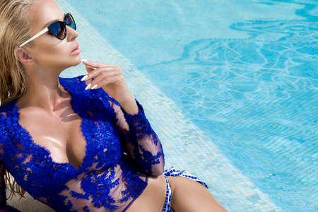 Sunglasses fashion model. Sexy elegant woman in sunglasses in pool in Cannes France. Bikini and sunglasses fashion. Elegance. Summertime.