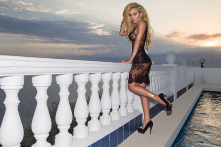 Sexy blonde model with lingerie on amazing view with sea in Spain. Sexy lingerie model - concept. Foto de archivo