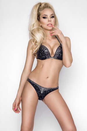 Sexy woman in elegant bikini on tanned, slim and shapely body isolated on white background. Bikini fashion. Archivio Fotografico