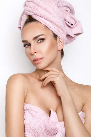 Beautiful blonde woman holding a face cream. Beautiful young woman with clean fresh skin. Facial treatment. Cosmetology, beauty and spa. Skin care - Image. Wellness.