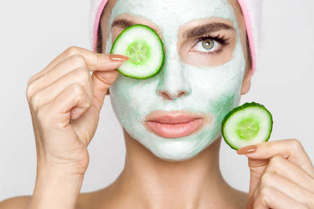 Beautiful blonde woman with moisturized face mask. Beauty spa. Skincare concept. Woman with facial mask. Stock fotó