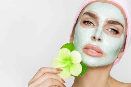 Beautiful blonde woman with moisturized face mask. Beauty spa. Skincare concept. Woman with facial mask. Foto de archivo