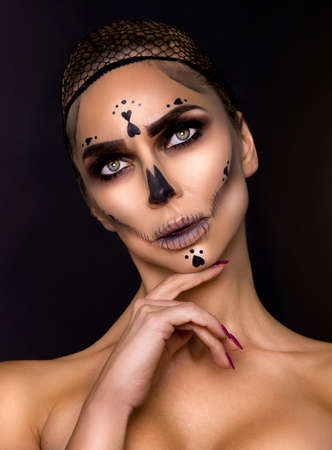 Halloween Sexy Witch portrait. Beautiful young woman in witches makeup with long curly blonde hair. Halloween makeup, visage. Wide Halloween party art design - Image