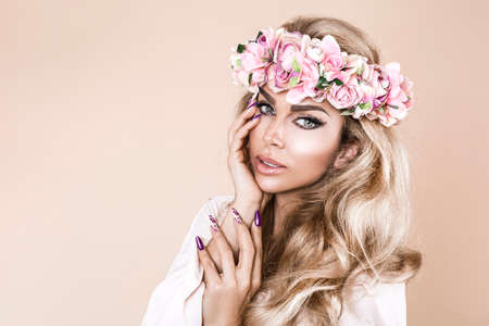 Spring concept.Manicure and nails. Beautiful natural woman in wreath with flowers. Spring manicure and makeup girl portrait. Beauty portrait of female face with natural skin. Spring fashion photo. Imagens