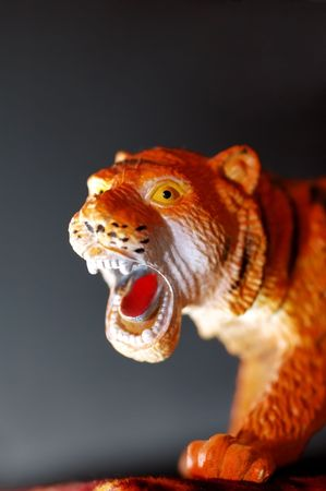 simplified: tiger toy with the wide-opened mouth Stock Photo