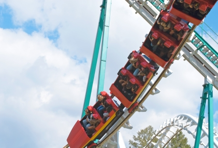 rollercoaster: red rollercoaster train is flying upside-down