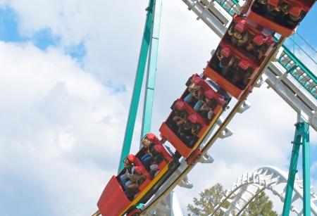 looping: red rollercoaster train is flying upside-down