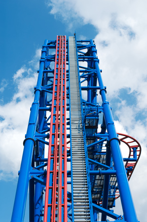 looping: huge thrill ride to blue cloudy sky