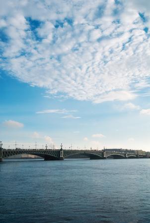 troitsky bridge over neva river at the cloudy day photo