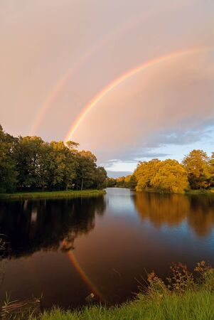 double reflected rainbow over autumn pond Stock Photo - 1665451
