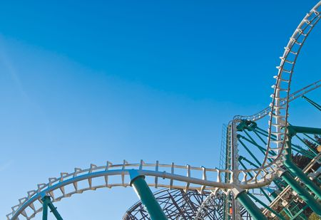 looping: curved rollercoaster tracks at the clear blue sky Stock Photo