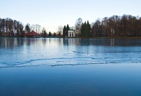 thin ice: blue pond under thin ice at the cold winter Stock Photo