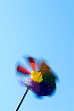 High-speed rotated pinwheel (wind-toy) at clear blue sky Stock Photo - 3306225
