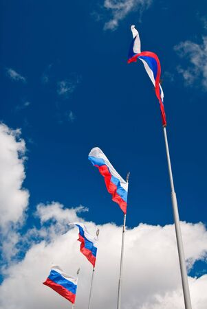 Four waving Russian flags with St.Petersburg symbol at the top over cloudy sky Stock Photo - 3379730
