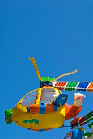 theme park: Flying empty children carousel helicopter at theme park