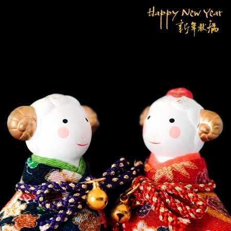 Pair of Chinese New Year bull toys with calligraphy wishes photo