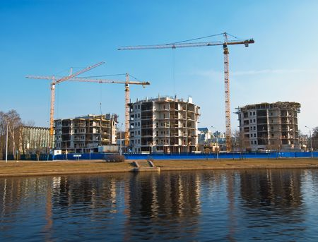 Construction place at the river front with reflection photo