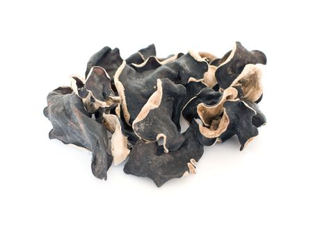 delicacy: Dried chinese delicacy black muer fungus isolated over white