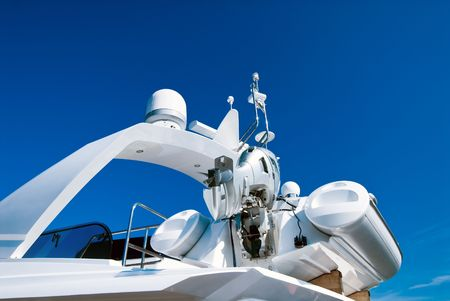 motorboat: Top of modern yacht with motor-boat over blue sky