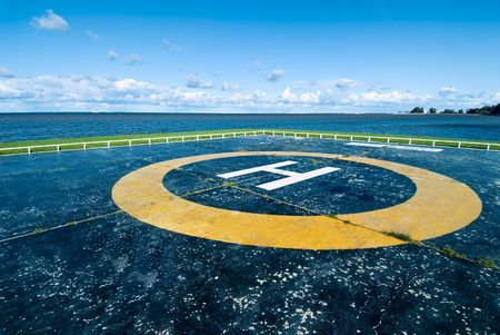 tree service business: Empty helipad at the sea shore of Peterhof, Russia