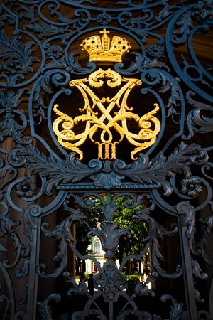 The Crown of Russian empire monogram at Hermitage museum (Winter Palace) wrought iron gate. photo