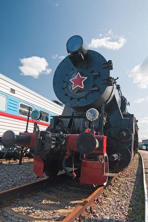 Retro soviet steam locomotive near modern passenger train Stock Photo - 5845276