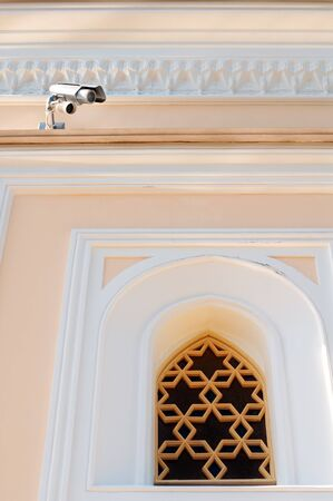 Small security camera near museum window photo