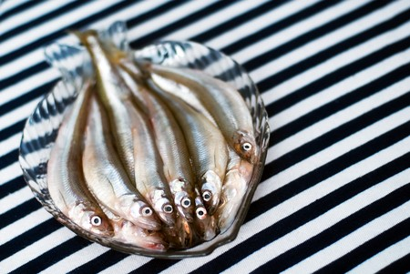 Famous fresh baltic fish smelt or korjushka over striped seaman fabric Stock Photo - 6987972
