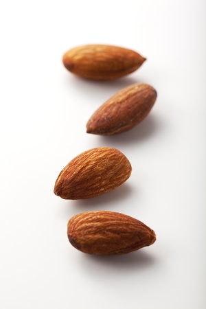 almond: Composition from almond nuts isolated on white background.