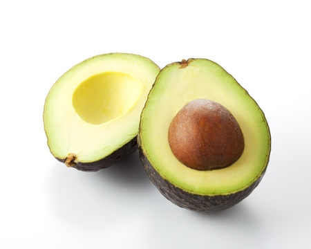 A fresh avocado cut in half.