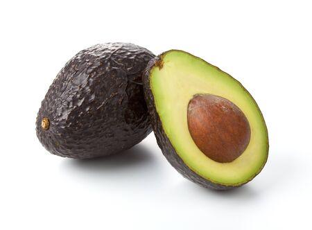 A fresh avocado cut in half.