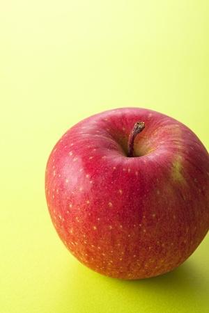 Fresh apple on isolated green background. photo